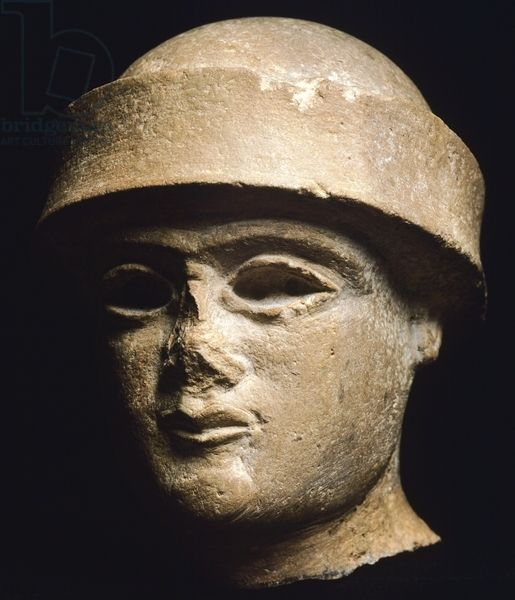 A kings head wearing a hemispherically domed, royal hat. Limestone artefact from Uruk, Iraq. Sumerian civilization, during the period of the Third Dynasty of Ur, 2100-2000 BC. Artwork-location: Bagdad, National Iraq Museum