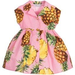 Baby girls pink pineapple print dress from Dolce & Gabbana. This shirt dress design has button through fastening, with a flat collar, short sleeves, a gathered waist and circle skirt. The dress comes with a matching pair of knickers that have an elasticated waistband and leg holes.