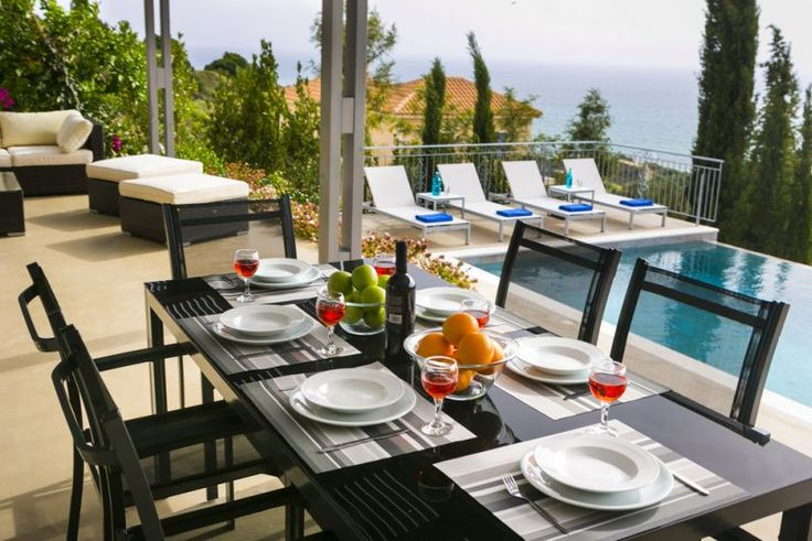 """The shaded veranda has both an outdoor suite and an """"al-fresco"""" dining area."""