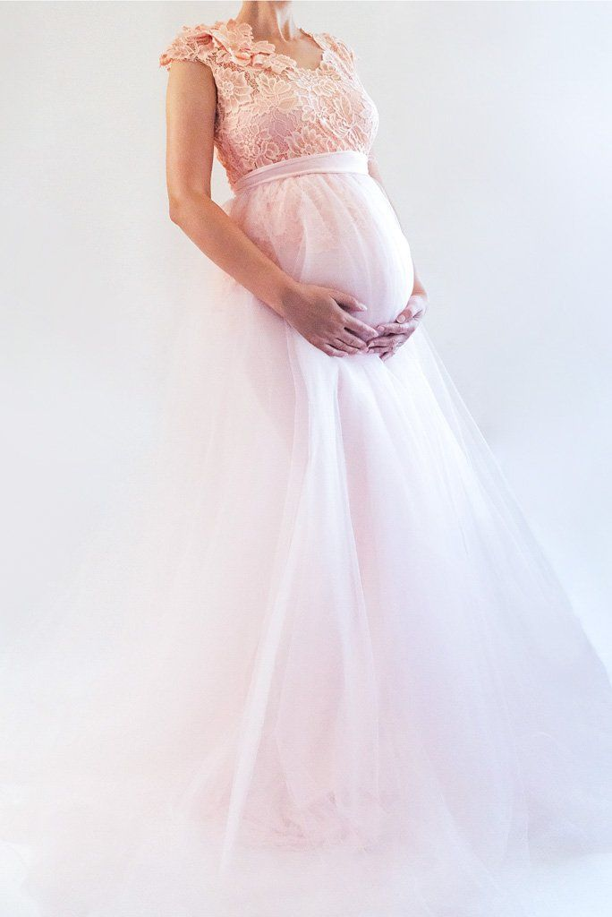 83313d204b This peachy blush gown is a breathtakingly beautiful tulle maternity dress.  With carefully cut out lace around the bodice