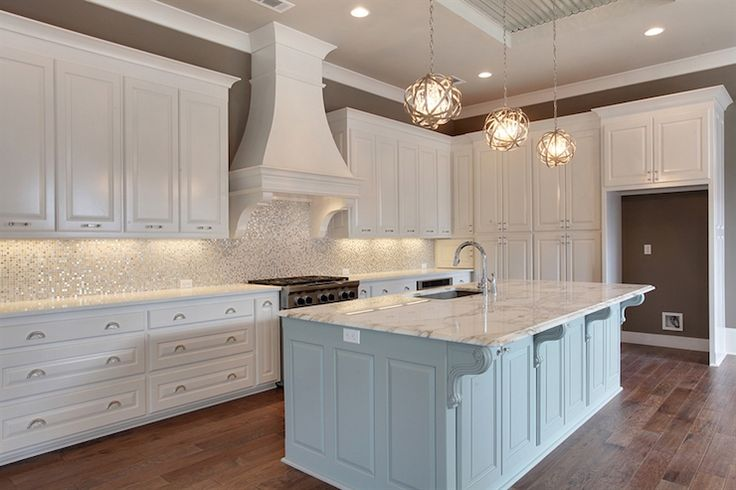 Gorgeous kitchen features crisp white cabinets accented with ...