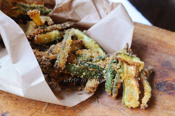 Zucchine croccanti al forno ricetta sfiziosa, contorno facile, zucchine impanate veloci al forno, ricetta leggera, contorno con verdure saporite, finger food di verdure