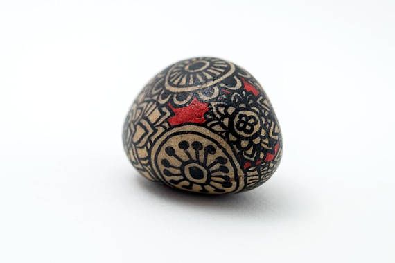 Unique gift! This hand painted zentangle mandala stone is one of a kind. The black mandalas cover the whole stone. This lucky stone adds some grounding to a red and black decor. It also can be placed as a desk decoration this mandala art will add color to any space. Acrylic painted black and red design. The stone art is varnished for indoor and light outdoor use. This unique rock was found while out for a walk along the river with the dogs. With its smooth sides it was hard to...
