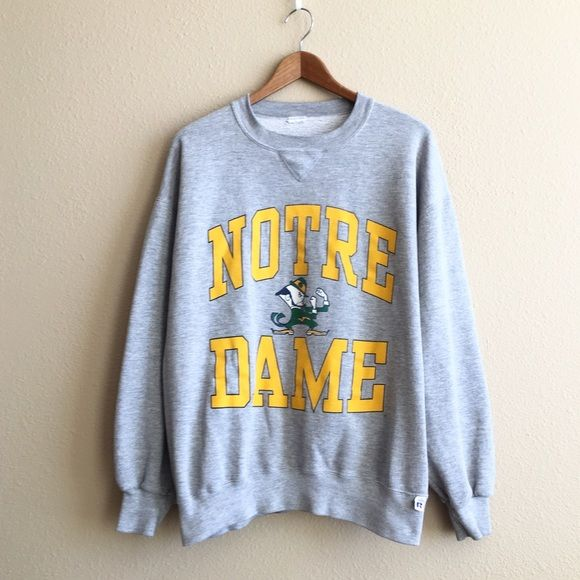 Vintage Notre Dame Sweatshirt Perfect work in cozy sweatshirt!  BRAND: - MATERIAL: 50/50 YEAR/ERA: 80s LABEL SIZE: - BEST FIT:   MEASUREMENTS: Chest  Length   ☠ No trades please!  Check out my closet for more vintage! Vintage Tops Sweatshirts & Hoodies
