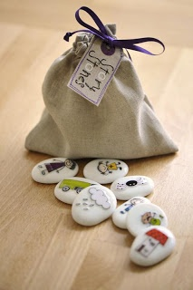 """Story Stones : She is not currently selling these but they would be easy to do for yourself. You could mod podge small pictures on paonted stone or even use those rub on tatoos. I've seen the block ones but I love the idea on stones. You could have them """"find"""" them in the yard to make up their story."""