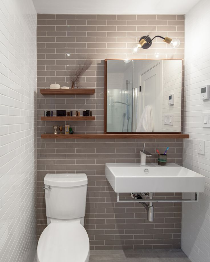 The custom designed mirror cabinet and display shelving, along with selection of fixtures and tiles, make this compact washroom layout simple and striking
