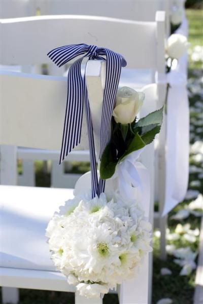 Navy stripes against white chairs - so nautical for a Cape Cod wedding. www.thecasualgourmet.com