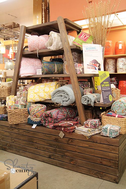World Market Bedding-I like the way that they tied up the bed linens, this would be a cute idea for the guest room extra linen sets