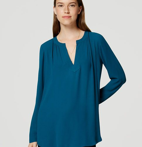 This perfectly minimalist tunic flaunts its flattering appeal with a clean split…
