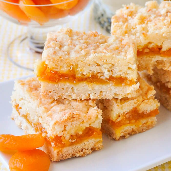 These Apricot Coconut Crumble Bars are a twist on a lemon version of the same cookie bars recipe but could easily be made with any jam filling you prefer.