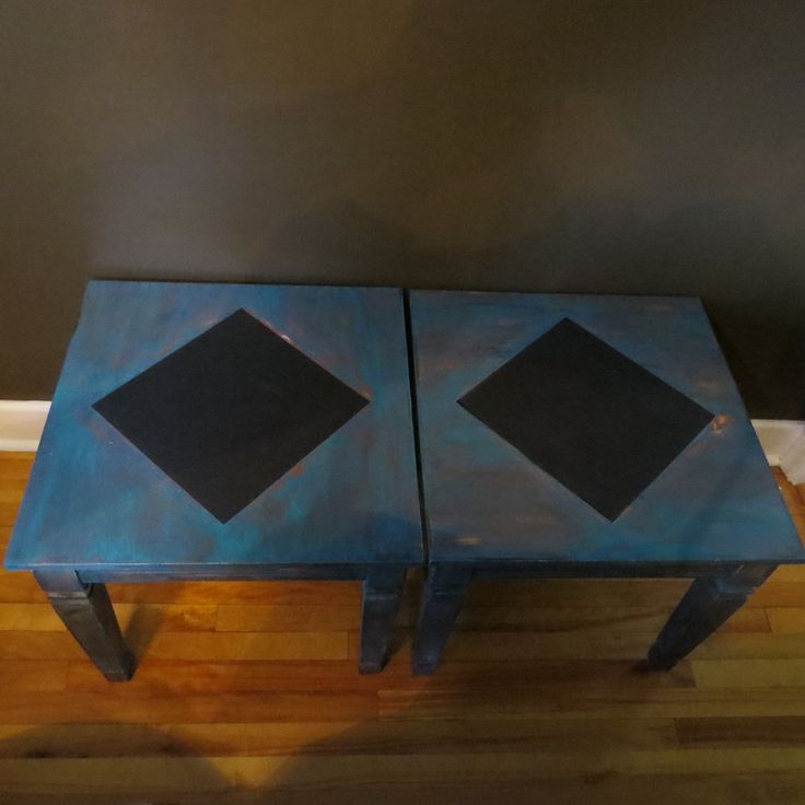 Farmhouse end table make over.  Tables are painted turquoise and glazed in a barn wood rust.  The diamond center is chalkboard.  These tables have also been distressed.  $150.00 for the pair.