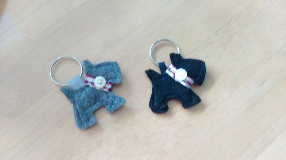Felt scotty dog keyring with ribbon and button detail. The dogs are the same on the front and the back making them perfect for using with your keys or as a bag charm.  This item is custom made to order so please allow 2 weeks for making and then upto a week for delivery. Orders will be posted using myHermes and a tracking number will be supplied once dispatched.