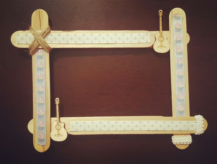 My DIY photoframe  Used: hot glue gun, scissors, string, dove craft ribbons, woden guitar shapes, popsicle sticks.