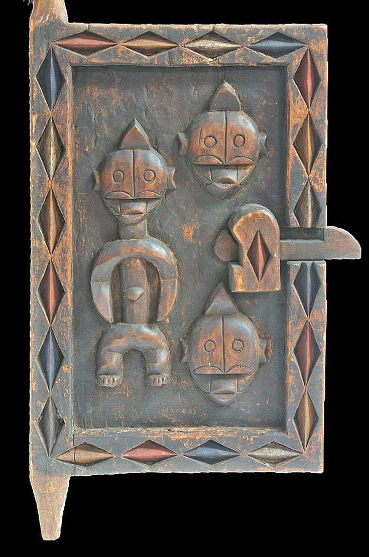 Africa | Granary door with lock, from the Fang people | Wood and pigment