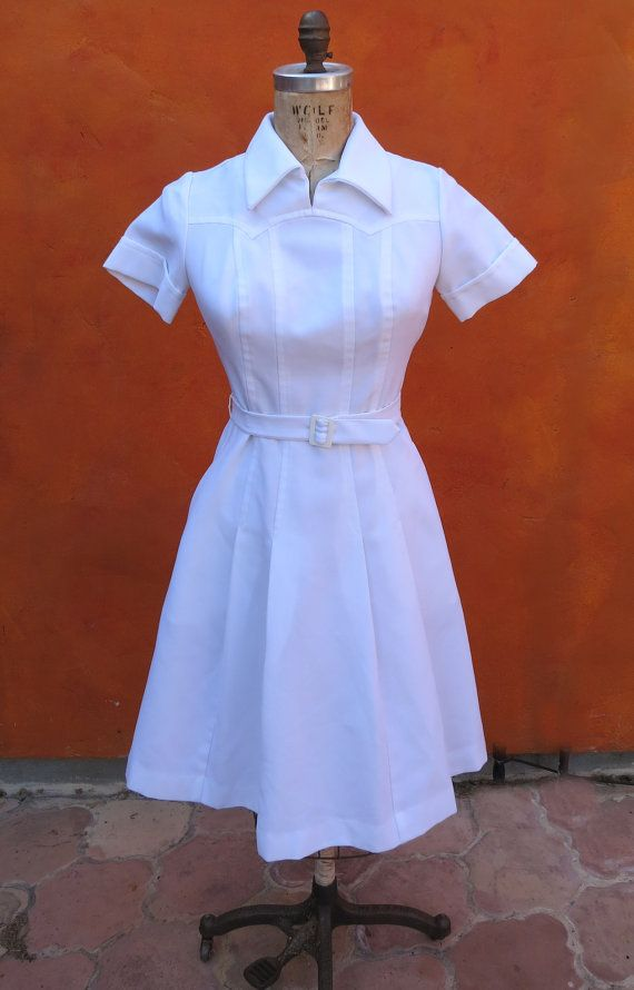 Really fun vintage white uniform  Zips in the back  Front side slit pockets  Poly.  Great condition! A few very very light small scuff marks. I have not tried to get these out - might very well just need a good cleaning. Waist : up to 29  Hip: up to 41  Armpit to Armpit (across front): 19  Armpit to Armpit (across back): 19  Length (armpit to hem): 33