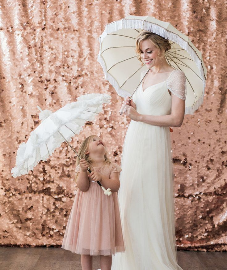 Tip #8. Umbrellas!! They will be your best friend throughout a rainy wedding and they can double as adorable photo props in some of your wedding