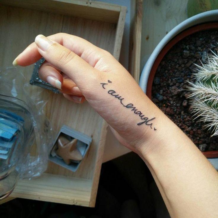 "tattoo reads: ""I am enough."""
