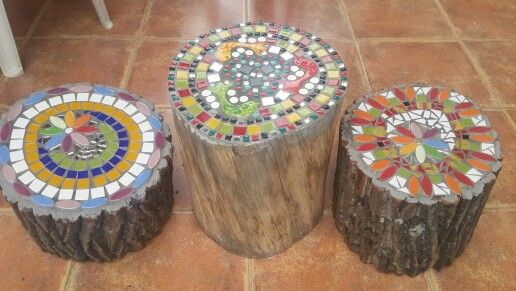 A craft morning with friends resulted in these mosaic tree stumps for our gardens.