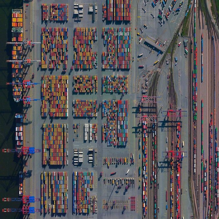 """The Port of Hamburg - known as Germany's """"Gateway to the World"""" - is located on the Elbe River in Hamburg. On an average day, the facility is accessed by 28 ships, 200 freight trains, and 5,000 trucks. In total, the port moves 132.3 million tonnes of cargo each year - that's roughly 1/3 of the mass of all living human beings."""