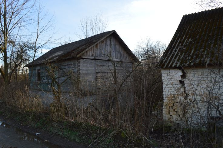 Long abandoned 18/19th century wooden farm house in the polish countryside...