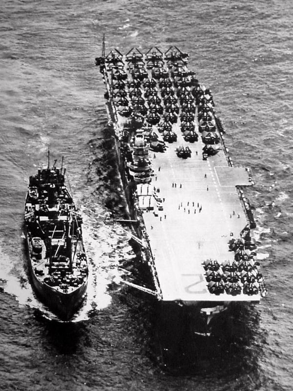 Overhead view of an ammo ship replenishing USS Hornet (CV-12), October 1944...feb16