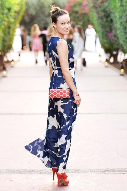 Olivia Wilde chose coral accessories – platform sandals and a geometric-print bag – to wear with her DVF blue and white printed maxi-dress.