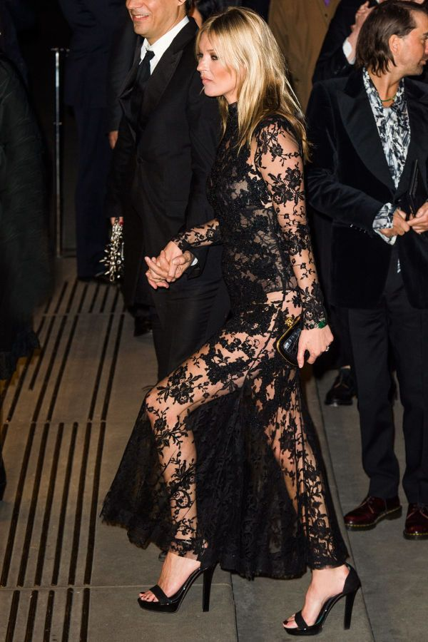 Kate Moss in a sheer black lace gown + black heeled sandals