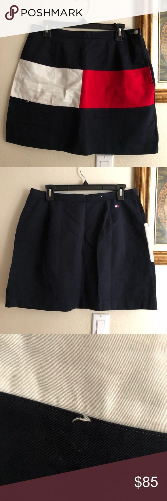 BIG LOGO Vintage Tommy Hilfiger Mini Skirt Size 14. Same skirt being sold for $150. Very rare find. Open to offers. See picture for loose string. Not noticeable at all. Tommy Hilfiger Skirts Mini