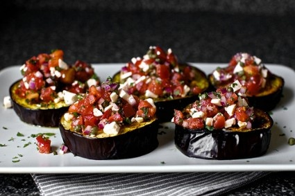 Aubergine with tomatoes, red onions, ricotta and mint