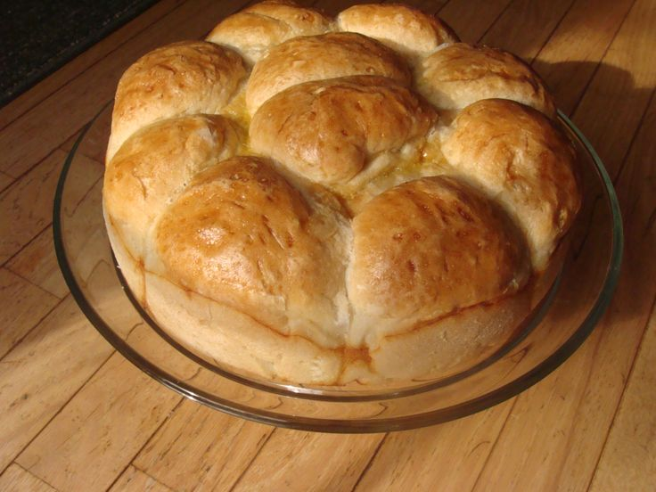 Pogacha (Po-Gotcha) This is a celebratory bread that Macedonians (and other Balkan Peoples) use when  celebrating weddings, Saints Patron days, baptisms,etc.  8 cups all-purpose flour  25 grams dry yeast (3 ½ envelopes of Fleischmann's ¼ oz. Active Dry Yeast pkgs)  1/2 cup lukewarm water    2 ½ tsp. salt  3 T + ¼ tsp. of sugar, for the dough  4 T + ¼ tsp. of oil, for the dough  1 to 1 ½ T of sesame seeds,    1 tbsp. oil,