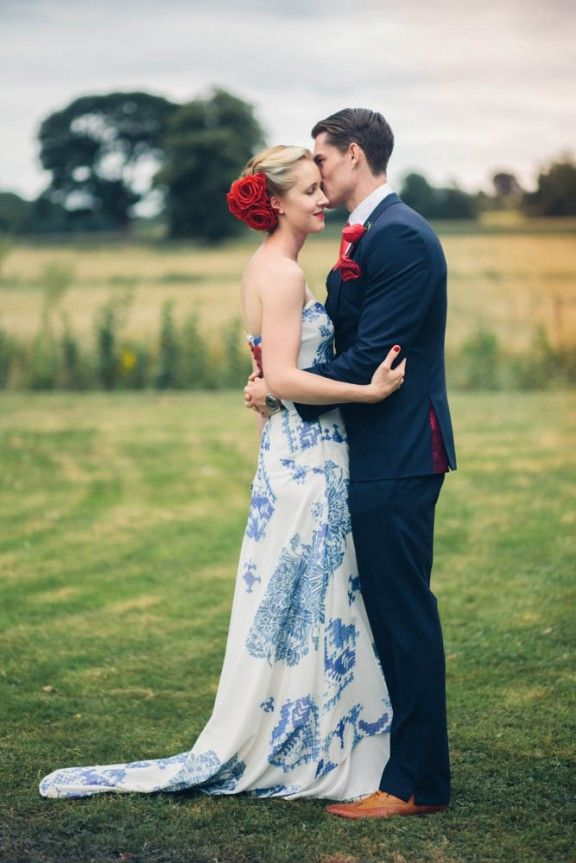 Alternative and untraditional colored wedding dress - blue & white patterned, plus bright red flowers in hair