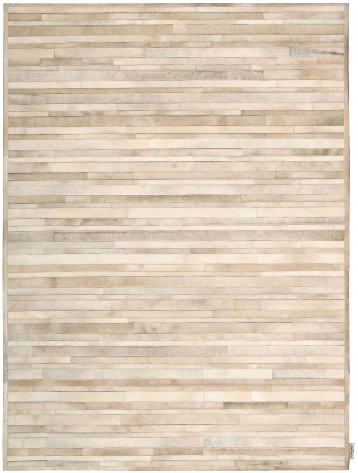 Calvin Klein Home Prairie Palomino Beige Rug brings the beauty of nature inside. A clean and concise design comprised of shifting bands placed side-by-side in a lustrous ground of calm ivory tones intertwined with hints of amber. The cowhides contrasting hues and alternating hair direction add to the design and sophistication of this unique all natural rug.