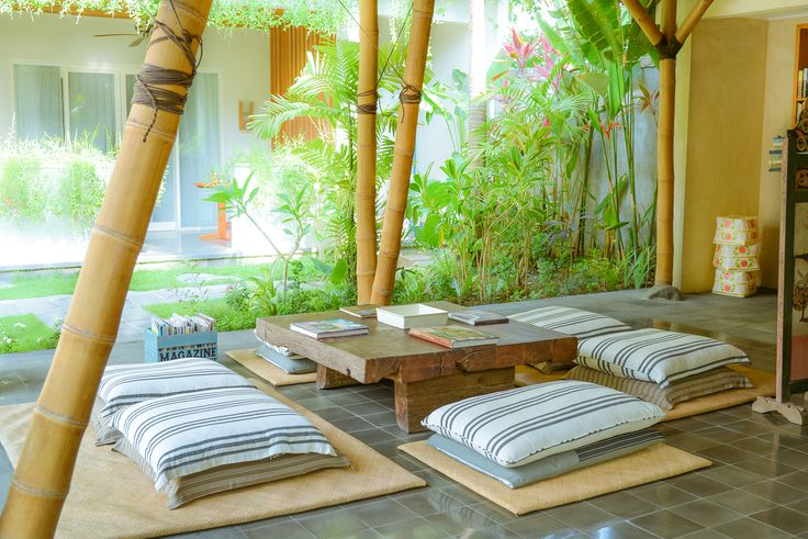 Chill-out area with cushions on the floor for reading in a relaxing manner overlooking the swimming pool.