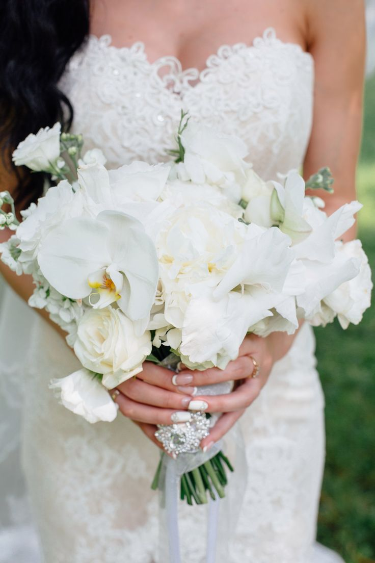 Wedding bouquet in white with orchid, roses and mantilla