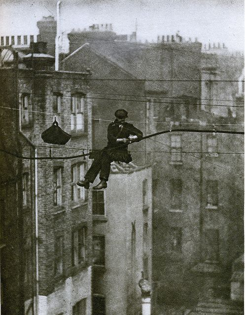 London in the 1920's.  Telephone engineer, suspended between Maddox Street and Conduit Street in Mayfair.
