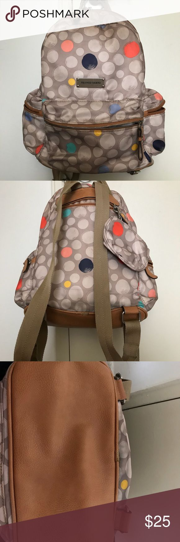 Franco Sarto polka dot backpack Tan & Multicolored polka dot backpack. Interior: one huge pocket, two cell phone pockets & one zippered pockets. Exterior: one front zippered pocket, one back zippered pocket & two side zippered pockets, also had a small detachable change purse. Adjustable straps. All together 8 pockets and one detachable change purse. I used it a lot for traveling but got a new back pack. All damage/defected pictured. All reasonable offers accepted. Franco Sarto Bags…
