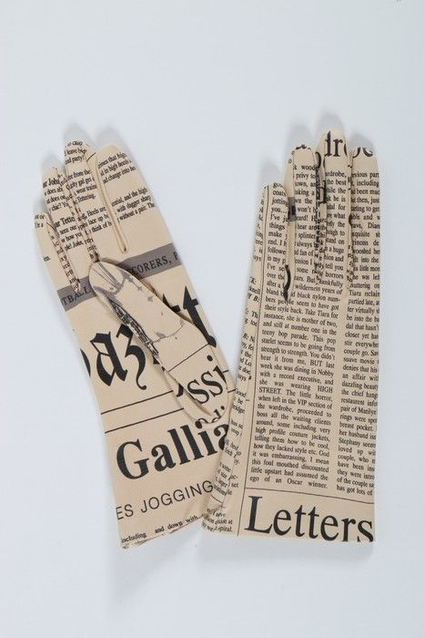 * pair of John Galliano newspaper print leather gloves, 2001.
