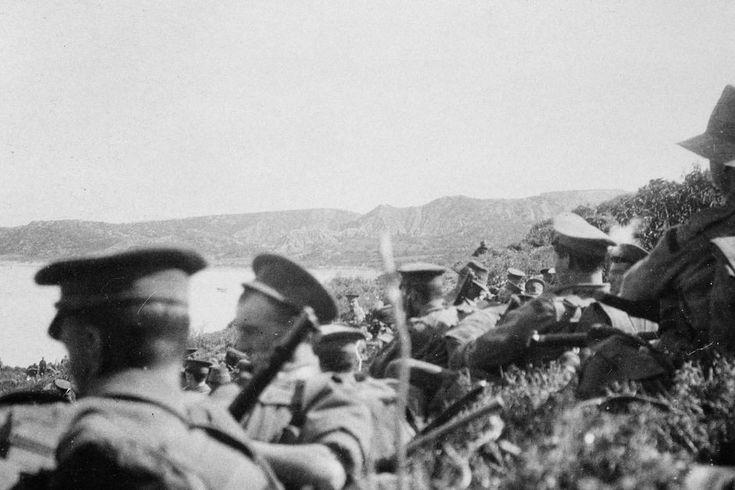1915: Australian Imperial Force solders await orders below Plugges Plateau overlooking Anzac Cove