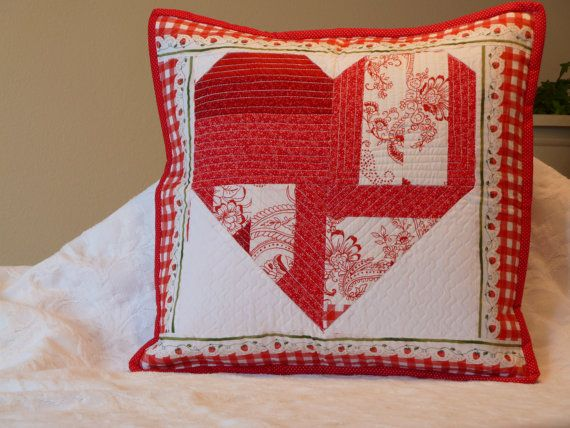 Red and white quilted heart pillow cover