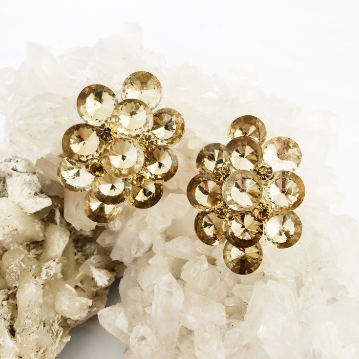 Bold and beautiful, the Dawn Glow Clip On Earrings by MOLTEN STORE are an essential for your eveningwear wardrobe. Inspired by all things antique, these intricate honey coloured earrings feature a combination of small cut crystals nestled among larger crystals, with a clear, secure clip-on backing. Wear this statement making style with your favourite evening dress for an instant vintage glamour look.