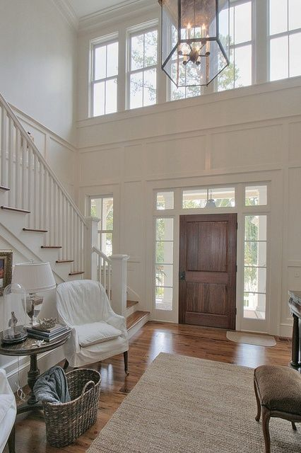 Hamptons style foyer entrance. Love the windows above the doorway.
