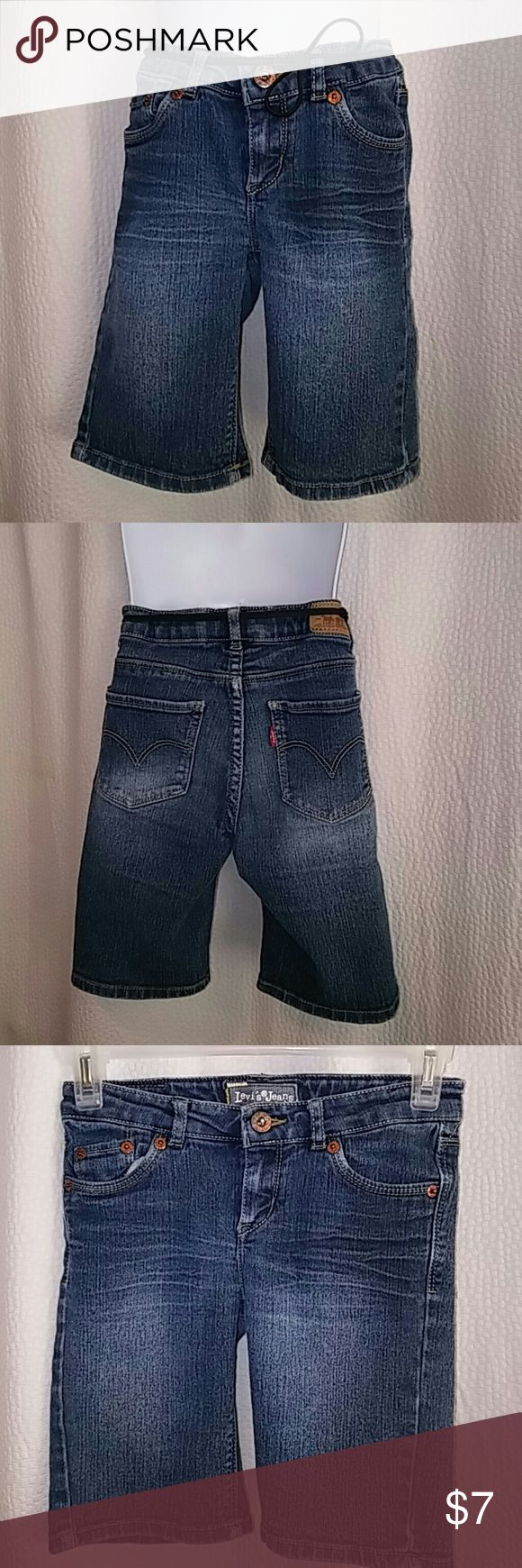 """LEVI STRAUSS BERMUDA SHORTS GIRLS SIZE 7 Very gently used girl's size 7 LEVI'S BERMUDA STYLE SHORTS. Soft cotton blend denim, these have the """"grow with you"""" buttons and elastic on each side of the waist hidden inside for extended seasons of use! Very cute and grown up! Levi's Bottoms Shorts"""