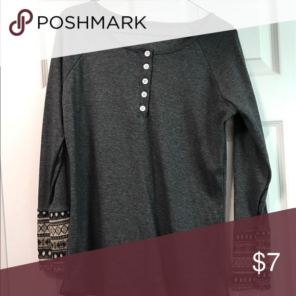 Cute Gray Henley Tee with Aztec Cuffs Size L This is a cute long sleeved Henley Tee I bought from a boutique and then never wore it! It has super cute Aztec patterns on the cuffs of the sleeves and is super soft. Size L. Pet free/smoke free home! Tops Tees - Long Sleeve