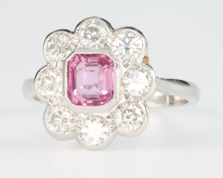 Lot 560, An platinum pink sapphire and diamond ring, the centre stone approx 1.05ct surrounded by brilliant cut diamonds approx. 1.2ct, size O 1/2 est £1300-1500