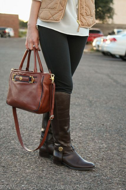 Tory Burch boots and a nude vest