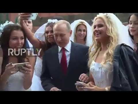 (177) Russia: Putin mobbed by young models dressed as brides - YouTube
