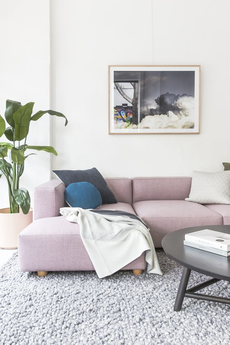 The Hawley Sofa has become the heart of this room, softened by assorted Nathan+Jac cushions and the incredibly plush Illusions rug. This contemporary black coffee table and art print add a touch of contrast.