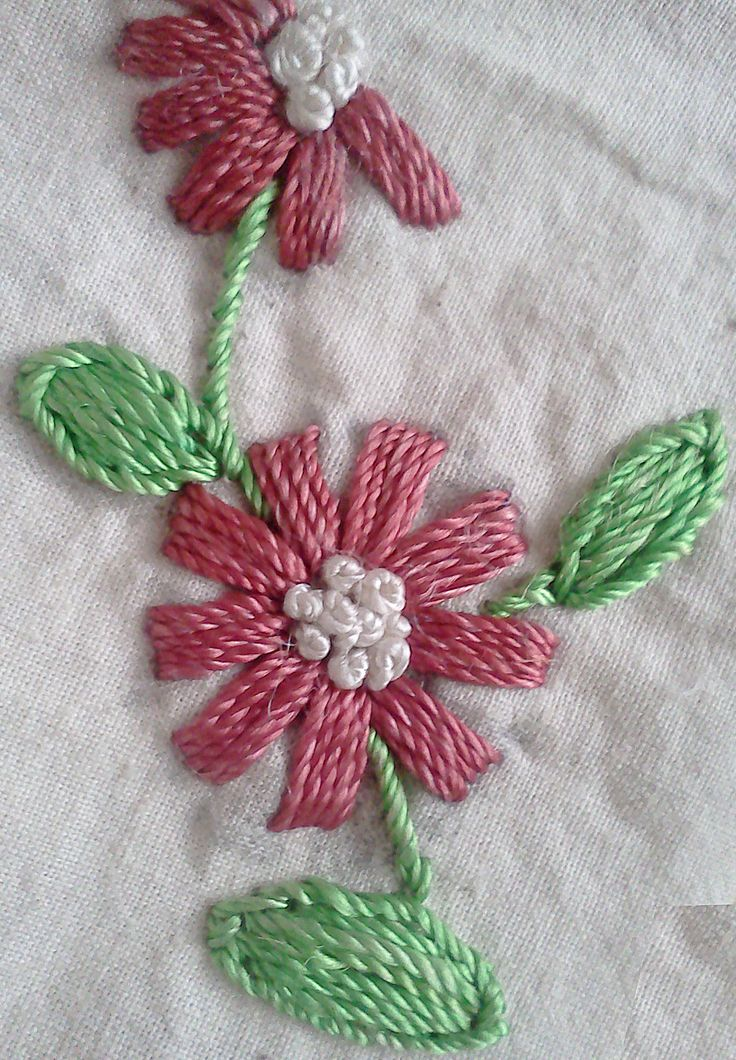 Petals of the flower are made with straight stitches with french knots at the center.