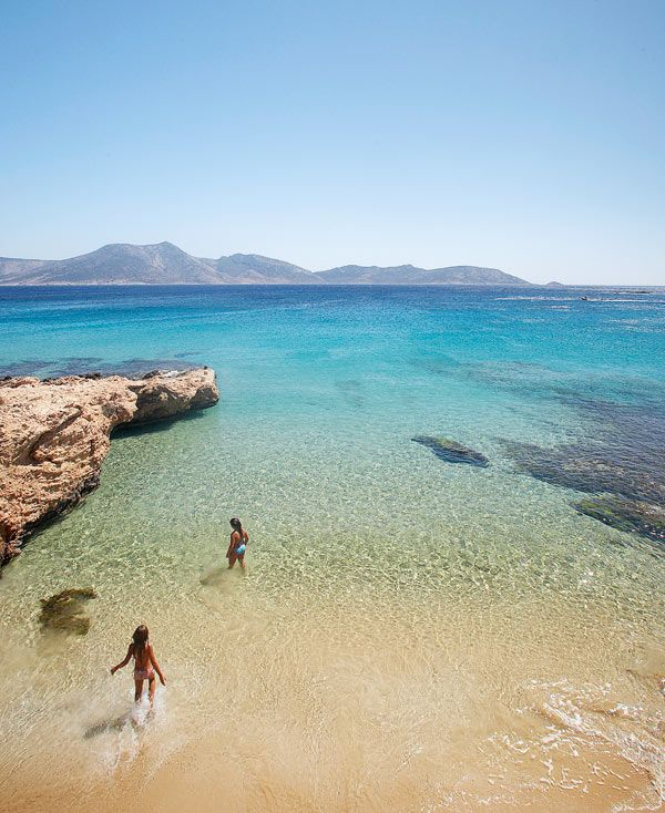 Giles Fraser and his small son visit Greece's Small Cyclades islands, little-known compared with neighbour Naxos, and all the more charming for that