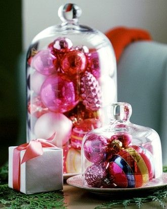 Let the garden inspire your holiday decorating: Display ornaments under a garden cloche -- a bell-shaped glass cover that functions as a miniature greenhouse for outdoor plants.
